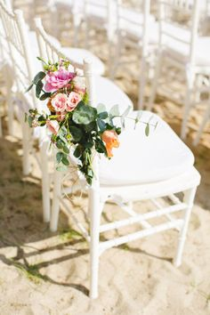 #roses and greenery decorating the ceremony chairs | Photography by gladysjem.com, Planning by http://chicconcepts.com.mx  Read more - http://www.stylemepretty.com/2011/09/12/boho-chic-inspiration-shoot-by-brienne-michelle-photography/