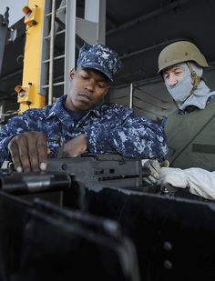EVERETT, Wash. (Sept. 5, 2014) Gunner's Mate 2nd Class Rylon McDuellbatiste, left, of Houston, and Aviation Ordnanceman 3rd Class Justin Busby, of Albuquerque, N.M., prepare a .50 caliber machine gun on the aircraft carrier USS Nimitz (CVN 68). Nimitz is currently underway performing routine operations and training exercises. (U.S. Navy photo by Mass Communication Specialist 3rd Class Kelly M. Agee/Released)
