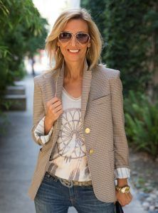 Jacket Features: Imported Italian fabric Color: Tan/Navy combo Semi Shaped Silhouette Notched collar and lapel Fully lined in a novelty stripe lining Shoulder pads 2 patch pockets in the bottom and one welt pocket on top 2 gold novelty button front closure 3 gold novelty button closure on each sleeve Contrast under collar Dry clean only Made in Los Angeles CA USA See How Nora Wears This Jacket In Her Blog Story
