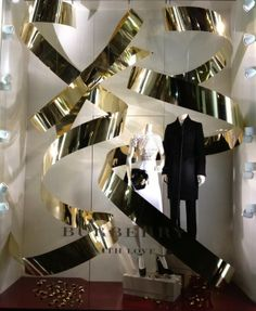 Burberry ribbons, pinned by Ton van der Veer