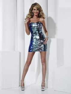 Everyone will take notice when you show up to your event wearing this knockout gown. This ombre sequined prom dress by Hannah S 27809 has a sweetheart neckline, sheath fitted dress, and short skirt. This prom dress is available only in multi. Make a statement wearing this red carpet cocktail dress. Finish this look with long crystal earrings and sexy heels to get the best look ever.