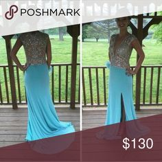 Prom Dress Turquoise color, has diamonds on the very top of it and all around it, has a little train. Dresses Prom