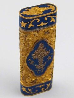 A cigarette lighter with enamelled yellow metal case, the lighter signed Cartier and numbered 34302G #cartier #lighter