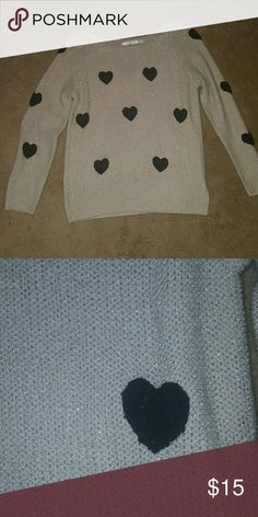 LC Sparkly gold sweater w hearts Sparkly gold sweater w black fuzzy hearts.... Wish I didn't have to part w this but too small for me.. The true color is more similar to pic 2.... pic 1 was enhanced to see the sparkly gold thread.... GUC.... Feel free to ask any questions like more pics or measurements!  ✅Make an offer through OFFER button ONLY ✅Negotiations welcome ❌No trades ❌No PayPal ✴Bundles encouraged✴ LC Lauren Conrad Sweaters