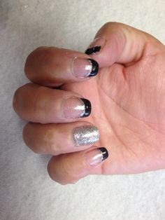 Black French with silver glitter accent line and silver glitter accent nail  Oasis Salon and Spa Mill Hall Pa (570)726-6565