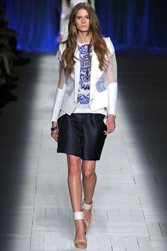 SPRING 2013 READY-TO-WEAR Just Cavalli; Piecing is used for eye-catching Spring jackets. Disparate mixes of materials – jersey, twill, leather, satin, jacquard – or same material in a different tone.