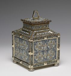 Peter Carl (Karl) Fabergé (Faberge) (1846-1920), Russian / silver and enamel tower shape tea caddy, decoration of crowned Sirins in pale blue circles surrounded by scrolls and geometric circles, rectangular with angled shoulders shape recalling a 17th-century teremok (tower or hut), workmaster Fedor Ivanovich Rückert (1840-1917), Russian, 1908-1917, silver gilding, filigree enamel, cork, Russia / Walters Art Museum, Baltimore, MD, USA