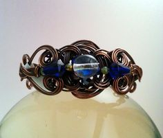 Wire Wrapped Copper Bracelet with Iridsecent Sphere & Cobalt Blue Beads by MysticMetalDesigns on Etsy