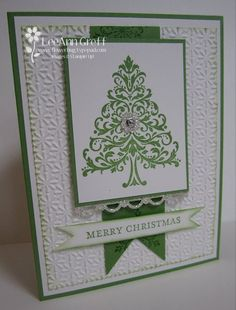 handmade Christmas card ... green and white with splashes of silver glitter paper ... flourish tree focal point panel ... like the green sponged edges on the white ... snowflake embossing folder background  .... pretty card ... Stampin' Up!