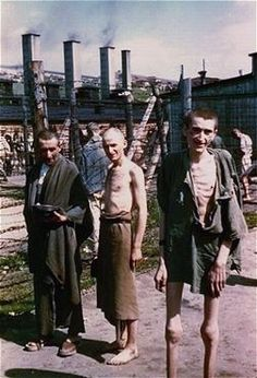"""Survivors in the """"Russian Camp"""" section of Mauthausen-Gusen Concentration Camp. Inmates were subjected to barbaric conditions, the most infamous was being forced to carry heavy stone blocks up 186 steps from the camp quarry. The steps became known as the """"Stairway of Death."""""""