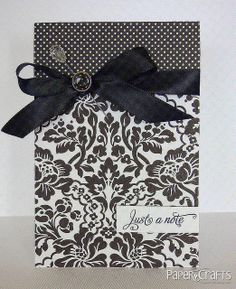 handmade card ... clean and simple design ... black and white ... damask print and dark polka dot print ... lovely black ribbon ... elegant and sophisticated look ...