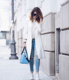 Wearing white converse with a matching white coat can create a gorgeous winter look. Nicoletta Reggio wears the trend with ripped denim jeans and a cute ...