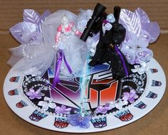 Transformers Wedding Cake Topper celebrating the marriage of Arcee and...Megatron?