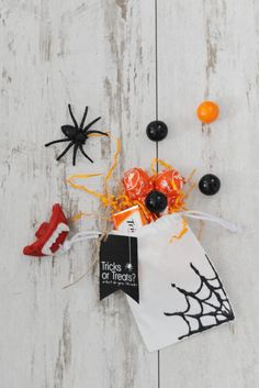 DIY Halloween Trick or Treat Bags with Glitter Spiderwebs.  Make these cute and easy DIY Halloween crafts for kids that come trick or treating in your neighborhood this year.  Get the free printable tricks or treats halloween tags here too.