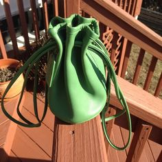 Coach Green Leather Littleton Drawstring Rare bag Almost vintage.  Seen in spring 1995 catalog. M4C- 4144. Pre owned in used condition. Minor scuffing. 99% of bag looks to be in good condition.   Rare and see on eBay selling for $150.00 new. Coach Bags Mini Bags
