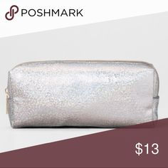 🌟 Silver Glitter Case🌟 🌟Can be used as a travel, makeup , accessories bag. 🌟Can organize your various makeup brushes and lipsticks,. 🌟The longer shape lends itself perfectly to storing combs, toothbrushes, mascara tubes and the like, while the zip-top closure makes it easy to quickly open and find your items.  🌟Dimensions: 3.0 inches (H) x 7.0 inches (W) x 1.0 inches (D) 🌟Main Compartment Closure:: Zip Closure Shell Material:: Nylon 🌟Interior Features: No interior pockets 🌟Care and…