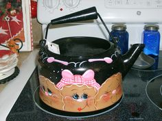 Tole Painted Antique Gingerbread  Tea Kettle. $25.00, via Etsy.