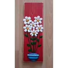 Vase of Daisy's. Painted rock/pebble art.