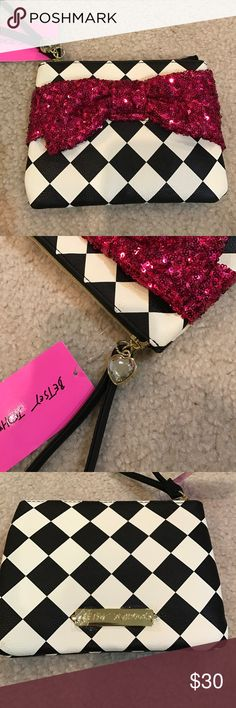 Price Drop💋Only Today! Betsey Johnson wristlet Brand new gorgeous magenta sequin bow wristlet. Black and white checkered pattern and rhinestone heart charm. No Trades or holds. Betsey Johnson Bags Clutches & Wristlets
