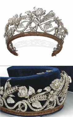 AN ANTIQUE DIAMOND TIARA mid-19th Century. Designed as a continuous scrolling old-cut diamond line with wheat sheaves, flowers, leaves and buds all interwoven, in a blue velvet fitted E. Böhm Vienna case.