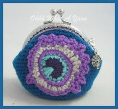 5. Crochet petrol blue coin purse with a crocheted peacock feather applique, silver-tone peacock charm,kiss clasp, purple fabric lining