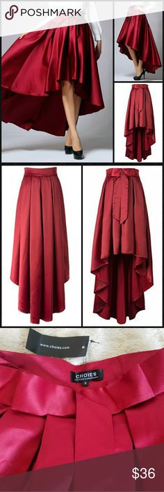 "NWT Stunning Red Satin High Low Skirt Talk about gorgeous!  NEW w/tag, this showstopper of a skirt is guaranteed to turn heads wherever you go! You will feel like a princess in this redsatin beauty, paired w/a cropped bustier or crisp white shirt.  Attached ribbon at waist, pleated skirt flares out to a dramatic high-low hem! Short lining is invisible when worn.  Labeled size 6 but runs small; please see measurements for best fit.   Flat waist 13""; length front 21.5"", back 42"". Skirts High…"
