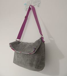 The Sling Bag FREE pattern- maybe with our grommets and a fabric or leather strap and then a button or snap to close it
