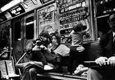 Black and white photograph of mother and children in a NYC subway in the 1970s.