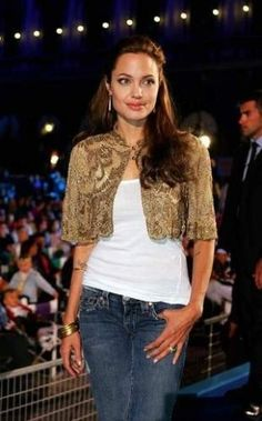 Anjelina Jolie in a cropped gold embellished jacket and jeans.  A rare change from her black monochrome outfits