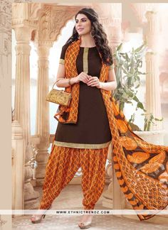 Add a adolescent burst of colour with your wardrobe with this brown cotton   designer patiala suit. The lace work appears chic and excellent for party and festival. Comes with matching bottom and dupa...