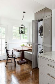 Incredible triple use of space --- eat-in kitchen w/window seat, laundry, back yard access.  Well done.