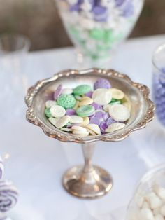 If you're planning on having a candy buffet at your wedding, you can't get much cuter than these pastel vanilla chocolate buttons.