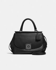 DRIFTER CARRYALL IN MIXED LEATHERS - It looks kind of like an old-timey doctor bag, but fresh and sleek!