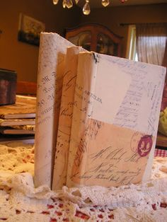 Jennifer Rizzo: Decoupaging old books with old letters...