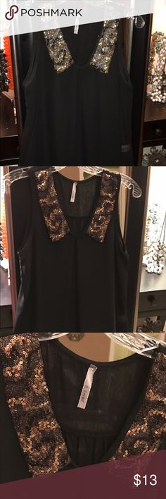 Black Sheer Sequence Collared Beautiful Blouse Beautiful Black Sheer Sleeveless Shirt with Sequined Collar. Great to pair with a black pencil skirt, nice trouser pants or cute skinny jeans. B envied Tops Blouses