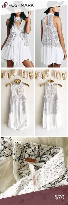 Free People Cross My Heart Lace Tunic Romantic lace and crepe pieced tunic with a swingy silhouette. Front and back keyhole cutouts with mother of pearl button closure at back neck. Sheer lace top with a crinkly crepe skirt.   36% Rayon, 33% Polyester, 31% Nylon Free People Tops Tunics