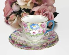 Antique Crown Staffordshire cup, saucer, and plate with pattern of pink and blue flowers, gilt trim, bone china, England, 1906 - 1930 by CardCurios on Etsy
