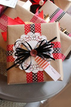 Washi tape, paper doily, ribbon, a button, and brown paper for a very pretty gift package!