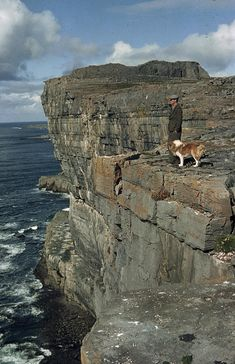 An Irishman With His Dog, Dun Aengus  -  Dun Aenqus is an ancient stone fort which sits high on a cliff in Inishmore, Ireland
