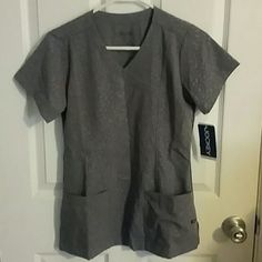 Jockey scrub top This is a brand new scrub top with 2 front pockets i have the matching pants in my closet as well perfect to bundle! Jockey  Tops