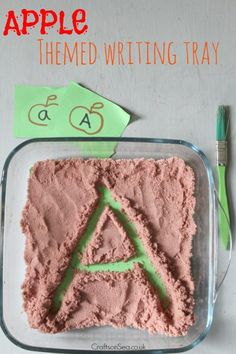 Learn how to easily dye sand to make this simple apple themed writing tray that's great for preschool or homeschooling.