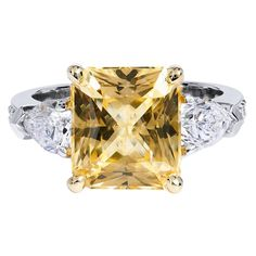 5.32 Carat Certified Yellow Sapphire Diamond Ring. Radiating an enchanting yellow aura, this handmade ring is crafted in platinum and features a no heat, natural 5.32ct AGL certified yellow sapphire