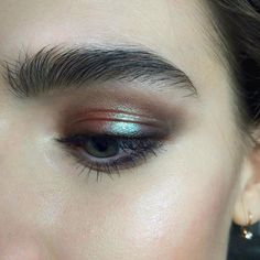 Give the holographic trend a try with iridescent bronze eyeshadow