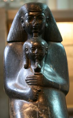 Seated Senenmut holding the princess Neferure in his arms, on display at the British Museum. Senenmut was a tutor to the princess Neferure and confidant (and possibly lover) of the pharaoh Hatshepsut. Neferure (or Neferura) was an Egyptian princess of the 18th dynasty. She was the daughter of two pharaohs, Hatshepsut and Thutmose II.