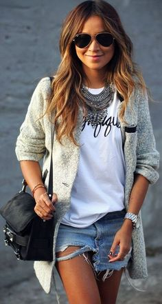 Sincerely Jules outfit #Summer #outfit #summernights : transition fashion from summer to fall. denim shorts and a white top. for extra warmth add a grey sweater. don't forget the statement necklace and black bag.