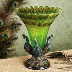 Make a statement and dress up a bouquet with this intriguing Peacock Vase Centerpiece. Vivid green resin, formed to resemble peacock feathers, creates this. Peacock Decor, Peacock Colors, Peacock Art, Peacock Feathers, Peacock Painting, Peacock Pics, Peacock Mirror, Peacock Bathroom, Peacock Crafts