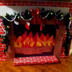 Who said you can't have a fireplace? Bulletin board paper . Construction paper and a little imagination and poof you havw Santa's portal  !