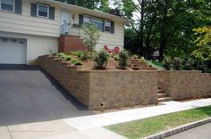 Retaining Walls for Driveways and Parking lots Retaining Wall Design, Landscaping Retaining Walls, Driveway Landscaping, Parking Curb, Parking Lot, Driveway Design, Front Entrances, Driveways, Outdoor Spaces