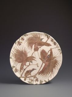 Raggiana Bird of Paradise Sgraffito wall art piece. Decorated with slips, carving and the technique of sgraffito shows a group of males displaying to a female. 40cm wide