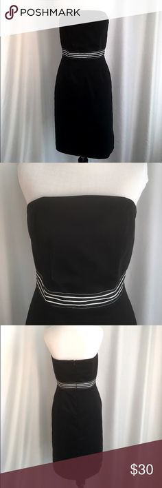 """White House Black Market Strapless Dress Beautiful black strapless empire waist dress from White House Black Market. The lined dress has a black and white striped grosgrain ribbon around the waist, back zipper and has boning in the bodice to help keep it in place. Cotton/Spandex. Size 6. Bust 35 1/2"""". Hips 38"""". Like new condition. No flaws or signs of wear. White House Black Market Dresses Strapless"""